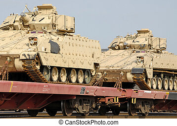 Military Tank Shipment - A freight train loaded with a ...