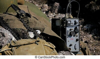 Military transmitter is close to a military ammunition. ...