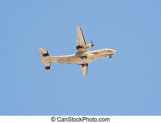Military transport aircraft in flight