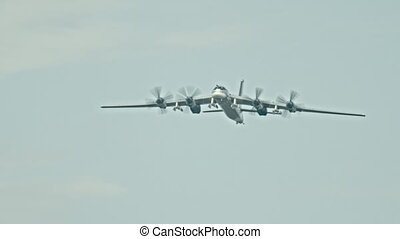 Military transport aircraft with four front vents flying in...
