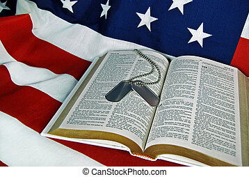 Military Tribute - Military dog tags on an open Bible.