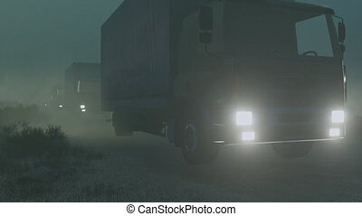Military trucks convoy at night - Military motorcade on a...