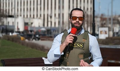 TV journalist is reporting from the conflict zone - Military...
