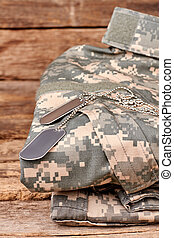 Military uniform and dog tags.
