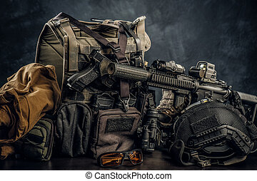 Military uniform and equipment. Body armor, gun, assault rifle, helmet, night vision goggles.