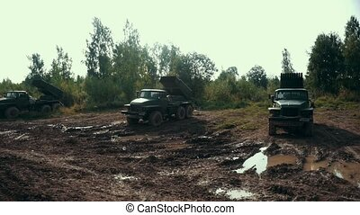 Military vehicle standing on shooting range. Military car on...