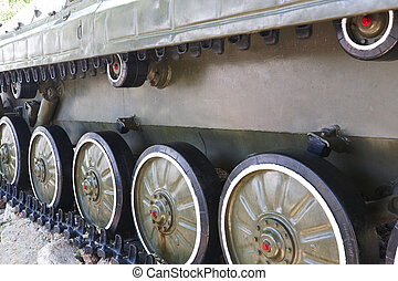 military vehicles running gear on tracks