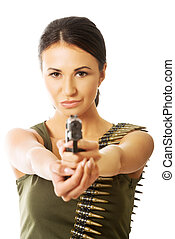 Military woman wearing bullet belt and shooting