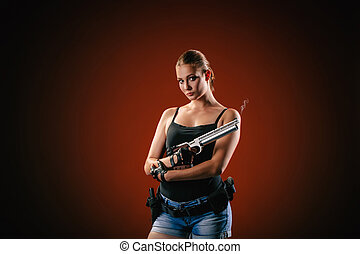 Military woman with a sport gun over black background