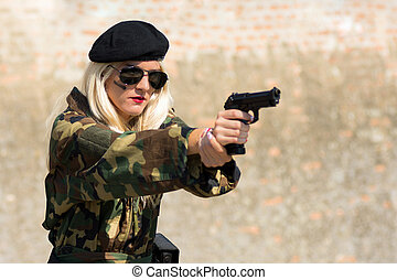 military woman with handgun