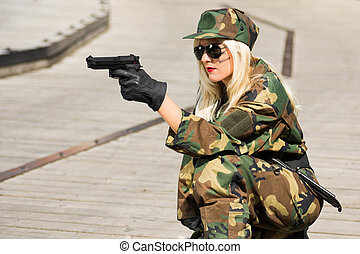 military woman with pistol