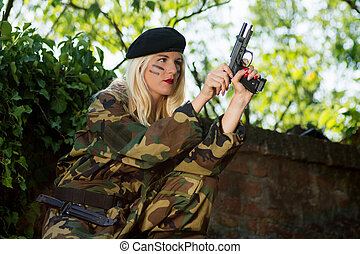 military woman with weapon