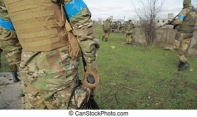 militias are fighting. Men in camouflage with guns and...