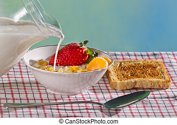 Milk and fresh fruit with corn flakes