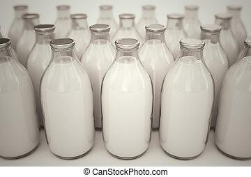 Milk bottles. - Front shot of old-fashioned glass bottles...