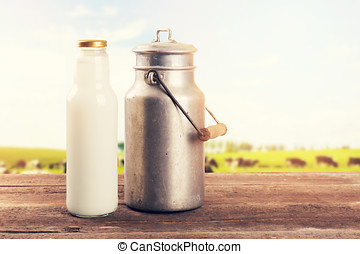 milk can and bottle on table near the cow pasture meadow