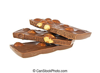 Milk chocolate bar with nuts on a white background, closeup