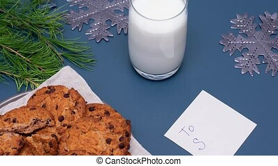 Milk, chocolate cookies and a note for Santa Claus. Note the...