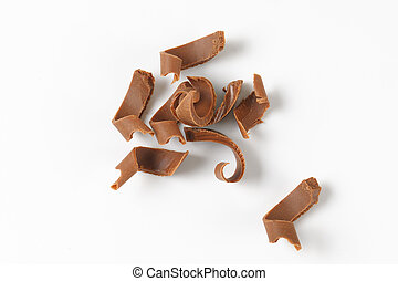 milk chocolate shavings on white background