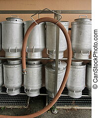 Milk churns at the dairy - Several milk churns in a row at ...