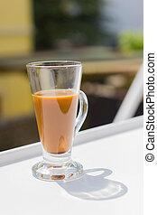 milk coffee in modern glass on white table, copyspace