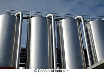 milk factory - Storage silos contain cleaning chemicals for...