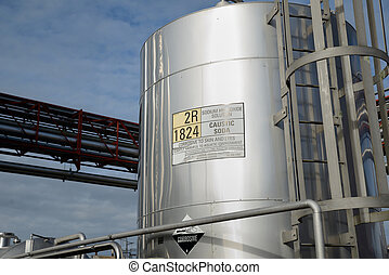 milk factory - A silo of caustic soda stores chemicals for...