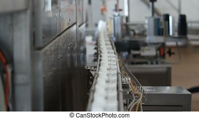 Milk in cardboard packages on a conveyor belt. Dairy...