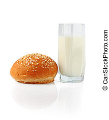 Milk in glass and roll