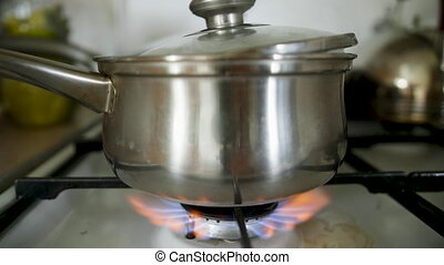 Milk or soup is boiled and flowed away on the stove.