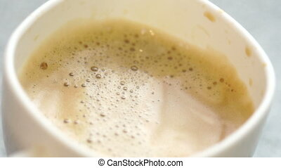 milk pours into the coffee