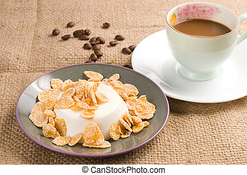 Milk pudding with sweet crips and coffee