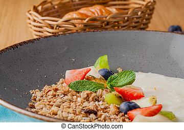 Milk rice porridge for kids healthy breakfast in cafe