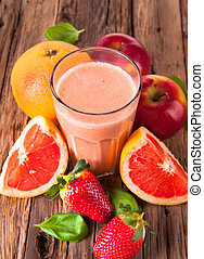 Fresh milk, grapefruit, apple drinkon wood background, assorted protein cocktails with fruits.