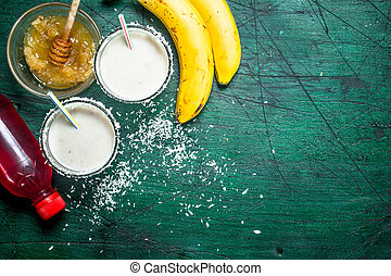 Milk smoothie with banana, strawberry syrup and honey.