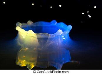 Milk splash, flying drops and bubbles
