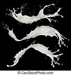 Milk splashes - Isolated shots of milk splashes on black...