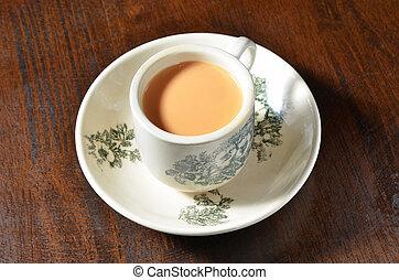 Milk tea - Cup of milk tea on wooden table