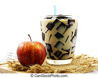 milk tea with black jelly in clear glass on white background