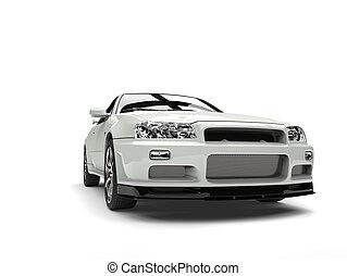 Milk white urban sports car - closeup shot