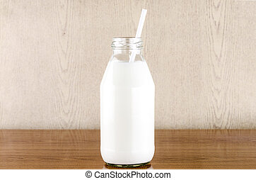 milk with straw in a glass of bottle