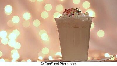 Milkshake on the background of Christmas garland