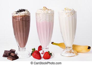 Milkshake on the table - Milkshake cocktail on a white...