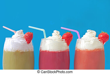 Milkshake smoothies - Three cream topped fruit smoothie...