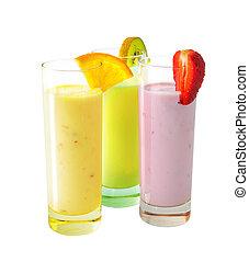 Milkshakes - Three different milkshakes with fruits isolated...