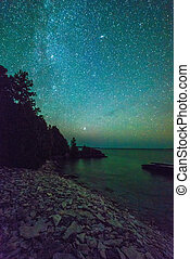 Milky way and starry sky along the lakeshore of Georgian Bay...