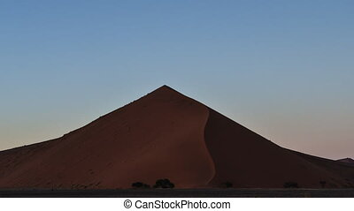 milky way galaxy rising over desert