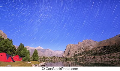 Milky Way in the mountains. Traces of stars similar to metory. Time Lapse. Pamir, Tajikistan