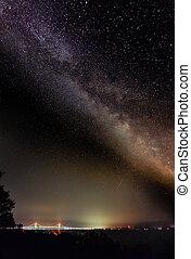 The Milky Way Galaxy shines in the night sky over Michigan's Mackinac Bridge.