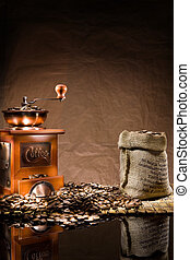 mill and bag with coffee beans